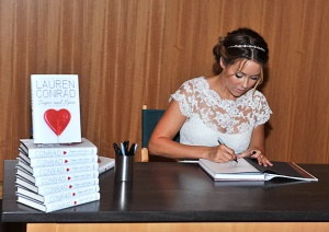 "Lauren signing her novel ""Sugar and Spice"" from the LA Candy Series. Photo/MTV"