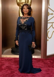 Best: Alfre Woodard looked absolutely stunning in this navy bejeweled gown. While she showed her decolletage, it wasn't over the top because of the tulle. The whole look is just sophisticated and gorgeous-- a simply curled bob, hoop earrings and a sparkling clutch complimented the outfit without taking away from the gorgeous gown.