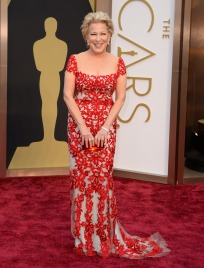 """Worst: Bette Midler did not look too hot in this Reem Acara gown. The cap sleeves are unflattering and the style is not good for her age or body type. While the material is pretty, it kind of screams """"Christmas tablecloth."""""""