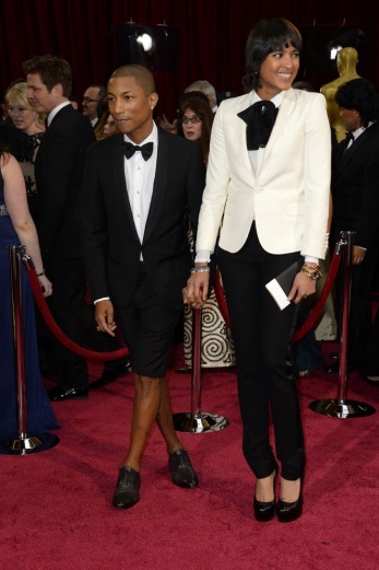 """Worst: Pharrell Williams loves to make a statement, but the """"Happy"""" singer looks like he forgot his pants with these bermuda shorts that make his legs look oddly feminine, while his date, Helen Lasichanh, seemed to have gotten style advice from Jared Leto."""